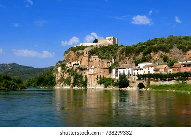 View of Miravet, Catalonia, Spain across the Ebro River. Miravet is topped by a medieval Romanesque castle once occupied by the Knights Templar.