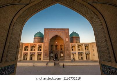 View of Miri Arab madrasah through arched gate, Bukhara, Uzbekistan.