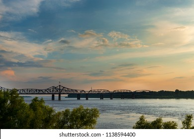 View of the Mississippi River with the Vicksburg Bridge on the background at sunset; Concept for travel in the USA and visit Mississippi