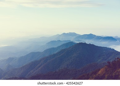 View of mist on the mountain at sunset over mountain range, mountain gap, mountain layer at Doi Ang Khang National Park, chiang Mai, Thailand