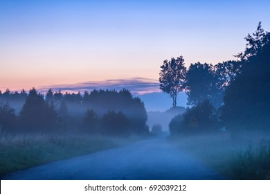 View of misty road after sunset