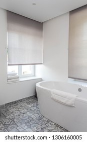 View of a Modern bathroom with white ceramic bath tub