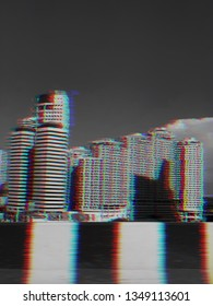 View of modern buildings from the street in the city background with glitch effect