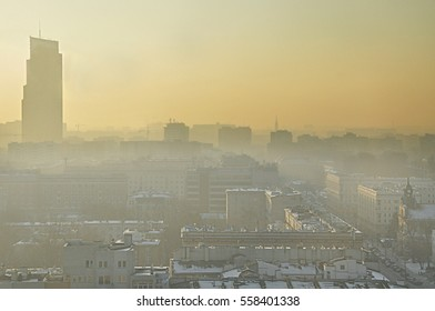 View of a modern cityscape covered in a dense smog and pollution, during sunset - Warsaw, Poland