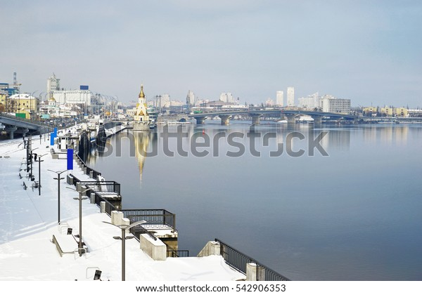 View of modern cityscape with river