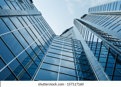 View of a modern office building from ground perspective.