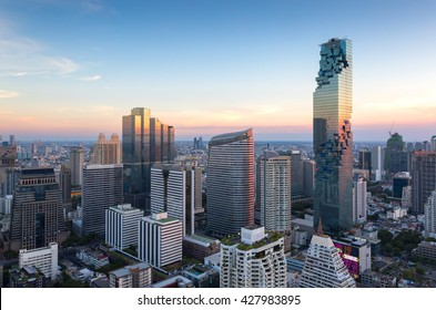 View of modern office buildings, condominium in big city downtown with sunset sky