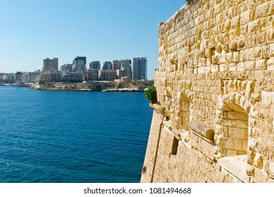 View of the modern quarter of Sliema from the Fort of Valletta. Tas-Sliema is a town located on the northeast coast of Malta in the Northern Harbour District.
