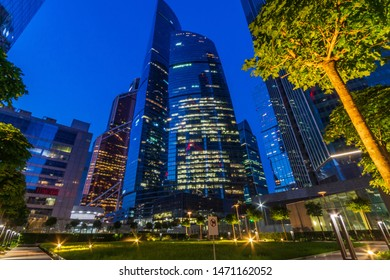 View of modern skyscrapers in business district in evening light at dusk