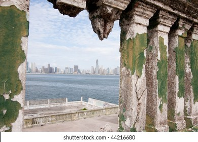 View of the modern skyscrapers of Panama City from inside the ruins of Club de Clases y Tropas in Casco Viejo. Panama City, Panama, Central America.