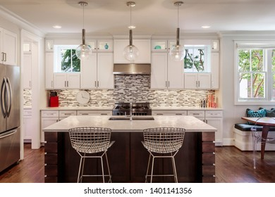 View of a modern upscale kitchen with the lights on