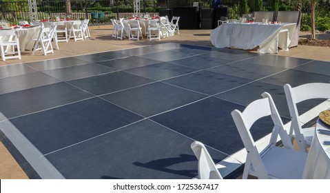 View of a modular dance floor at a wedding reception. Party rental equipment.