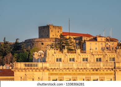 View from Molo Audace to hill with castle Castello di San Giusto on sunset in Trieste, Italy