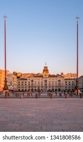 View from Molo Audace to main square Piazza Unita d Italia on sunset in Trieste, Italy