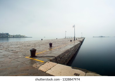 View of Molo Audace in a rainy day, Trieste