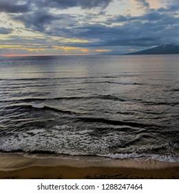 View of Moloka'i at sunset from Kaanapali