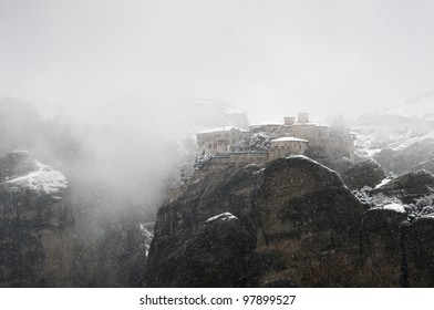 View of the monastery covered with snow in a cold windy weather, Greece