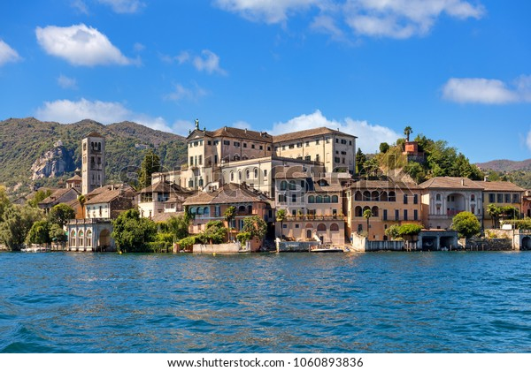 View of monastery on famous San Giulio island on Lake Orta in Piedmont, Northern Italy.