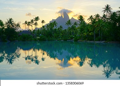 View of the Mont Otemanu mountain reflecting in water at sunset in Bora Bora, French Polynesia, South Pacific