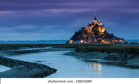 View of the Mont Saint-Michel mountain village at night in France