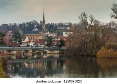 View of Montbeliard town at sunset in Doubs region, France.
