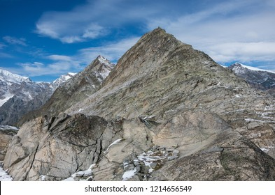 View to Monte Moro mountain from Monte Moro pass near Macugnaga, Monte Rosa massif at background, Italy. Panorama