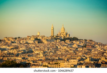 View of Montmartre hill and the Basilica of the Sacred Heart of Parisat sunset, France, Europe