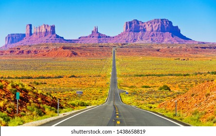 View of Monument Valley on a sunny day near the border of Arizona and Utah in Navajo Nation Reservation in USA.