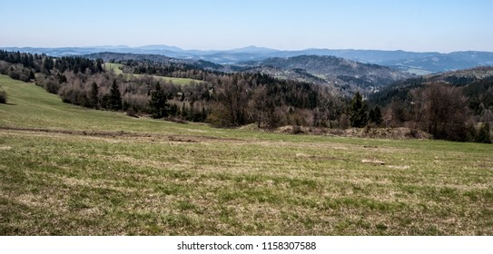 view to Moravskoslezske Beskydy mountain range with highest Lysa hora hill from Vrchrieka hill in Javorniky mountains in Slovakia during spring day with clear sky