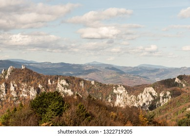 view to Moravskoslezske Beskydy mountains from Kecka hill in Sulovske skaly mountains in Slovakia during autumn day with blue sky and clous