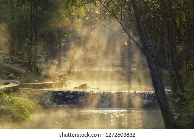 view morning of Tha Pai Hot Spring or Pong Nam Ron Tha Pai in Thai around with the mist and soft sun light background, Pai District, Mae Hong Son, Thailand.