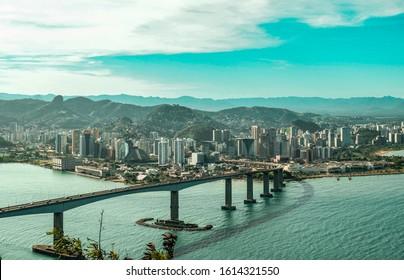 View from Morro do Moreno in Vila Velha city to Vitoria City and the Terceira Ponte Bridge, Vitoria Bay and blue sky.