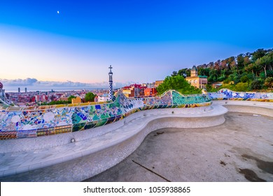 View of mosaic tile and Barcelona cityscape in park Guell at sunset | Spain