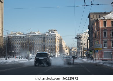View of Moscow city traffic in historical center in winter. Cars drive along Moscow streets