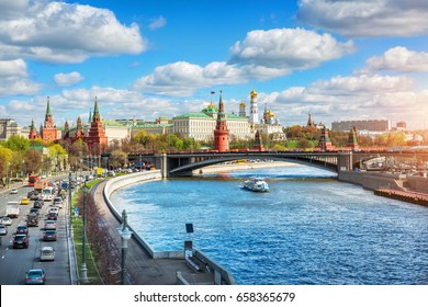 View of the Moscow Kremlin by a sunny cloudy day and Moscow transport: cars and a ship