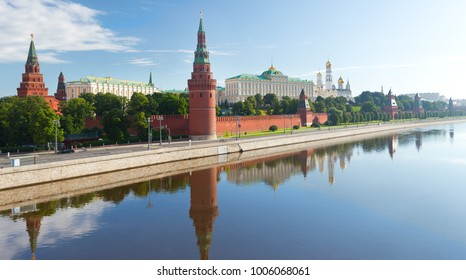 view of the Moscow Kremlin with reflection in Moscow river, summer day