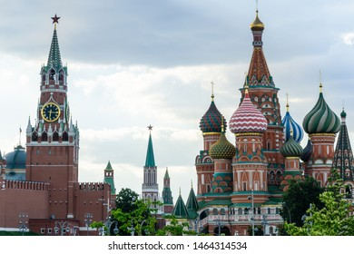 View of the Moscow Kremlin, the Spasskaya Tower and St. Basil's Cathedral. Summer evening in Moscow in June 2019. Soft selective focus
