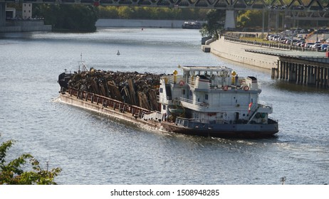 View of Moscow river and barge with scrap metal from quay.