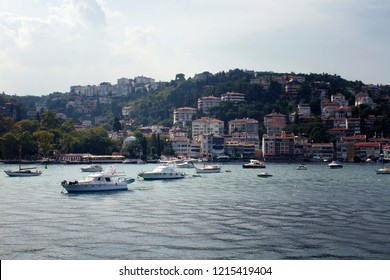 View of motorboats and yachts, buildings on European side and Bosphorus in Istanbul. It is a sunny summer day.