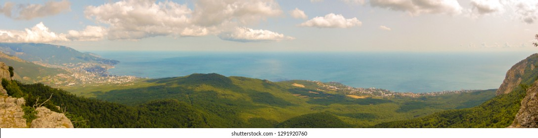 View from mount AI-Petri on the Black sea in the Crimea. On the left is the city of Yalta. Panorama of 4 pictures