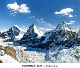 View of mount Cholo, Kangchung peak and Nirekha peak, way to Cho Oyu base camp, Gokyo valley, Sagarmatha national park, Khumbu valley, Nepalese Himalayas