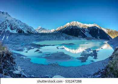 View of Mount Cook (Aoraki), Mount Wakefield, Mueller Glacial Lake and Mueller Lateral Moraine from Kea Point, New Zealand during early Spring