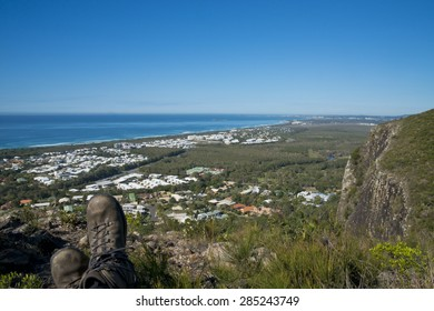 View from Mount Coolum Sunshine Coast, Queensland, Australia. Image shows area South of Mount Coolum with settlements (Yaroomba and Mudjimba) and ocean. Blue sky and rock wall on right.