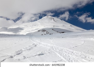 View of Mount Elbrus (5.642 m) from the south-east. The ascent path along the southern slope is through the Shelter 11 and Pastukhov Rocks.