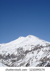 View to Mount Elbrus of the Caucasus Mountains in Russia. Snow-covered mountain peaks with two peaks. The highest mountain of the Europe - Elbrus, 5642m