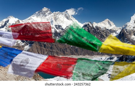 view of Mount Everest with buddhist prayer flags from Renjo La pass - Nepal