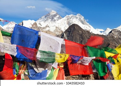 view of Mount Everest and Lhotse with buddhist prayer flags from Gokyo Ri - way to Everest base camp, Sagarmatha national park, Khumbu valley, Solukhumbu, Nepal Himalayas mountains