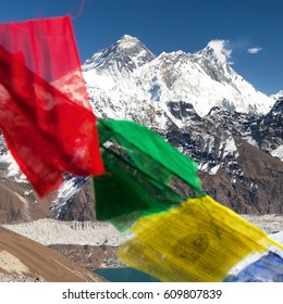 view of Mount Everest and Lhotse with buddhist prayer flags from Renjo La pass - Nepal