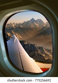 View of Mount Everest through an aircraft window. Everest is a mountain in the Himalayas, on the border between Nepal and Tibet. Rising to 8848m (29,028ft), it is the highest mountain in the world.