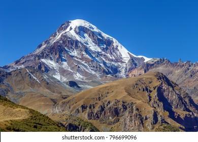 View of Mount Kazbek from Gergeti Trinity Church in autumn, Georgia